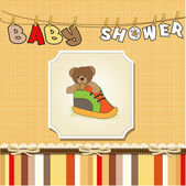 Baby shower card with teddy bear hidden in a shoe — Stock Photo
