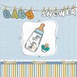 Baby boy shower card with milk bottle and pacifier - Stock Photo