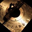 Stock Photo: Very old golden sundial beneath