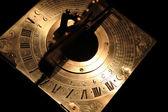 Very old golden sundial beneath — Stock Photo