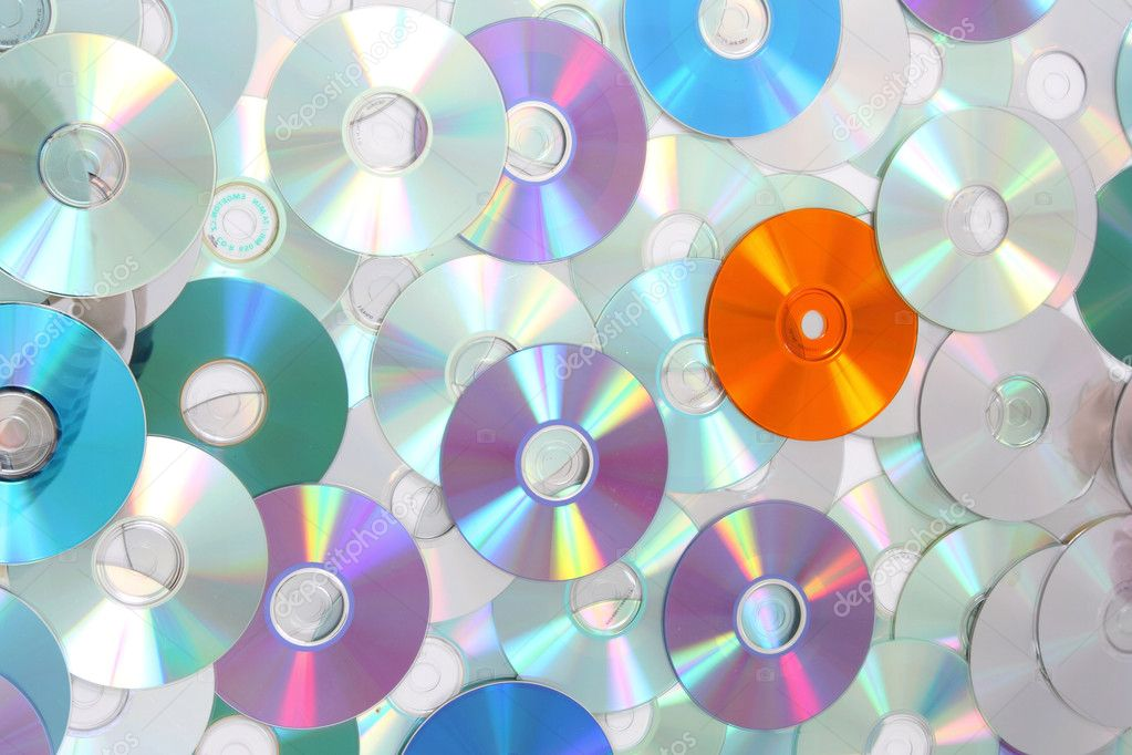 CD and DVD background in the different colors — Stock Photo #9812046
