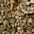 Stock Photo: Stacked logs of firewood