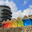 Stock Photo: Beach chalets and tourst hotel