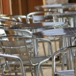 Vacant metal chairs and tables — Stockfoto