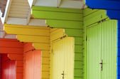 Colorful beach chalets or huts — Stock Photo