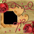 Vintage photo frames, red roses and heart - Stock Photo