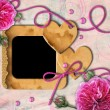 Vintage photo frame, pink roses and heart - Stockfoto