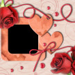 图库照片: Vintage photo frame, red roses and heart