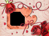 Vintage photo frame, red roses and heart — Stock Photo