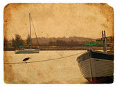 Fishing boat near the shore. Old postcard. — Stock Photo