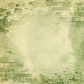 Green wall, brick, cracked paint — Stock Photo