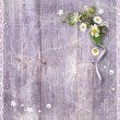 Old wooden planks with a bouquet of flowers — Stock Photo