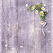 Stock Photo: Old wooden planks with a bouquet of flowers
