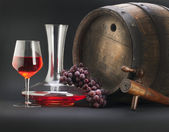 Red wine with barrel and decanter — Stock Photo