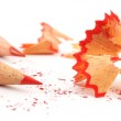 Red crayon wiht shavings — Stock Photo #10596610