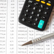 Chart with calculator and pen — Stock Photo