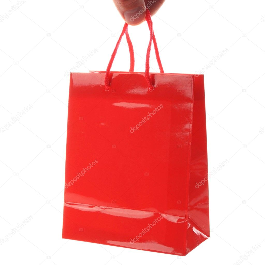 A red shopping bag isolated on white background — Stock Photo #9843460