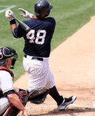 Baaeball batter swinging and hitting the ball — Stock Photo