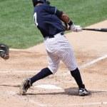 Left-handed baseball batter, close-up popping up — Stock Photo