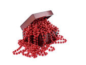Red christmas garland in wooden box — Stock Photo