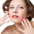 Woman with red nails and lips — Stock Photo