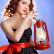 Girl with a kerosene lamp - Stock Photo