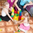 Children play with their parents — Stock Photo