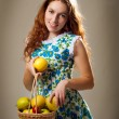 Girl with the apples — Stock Photo #8346841