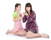 Woman and a daughter play with a hamster — Stock Photo