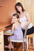 Mum does homework with a daughter — Stock Photo