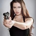 Girl aiming a gun — Stock Photo