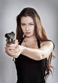 Girl aiming a gun — Stock Photo