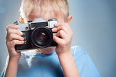Child with a camera — Stock Photo