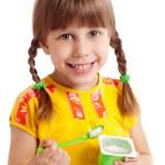 Child eating yogurt — Stock Photo #9591569