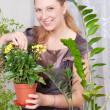 Girl takes care of flowers — Stock Photo #9591601