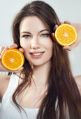 Portrait of a girl with an orange — Stok fotoğraf