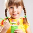 Child eating yogurt — Stock Photo