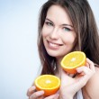 Portrait of a girl with an orange — Stock Photo #9724095