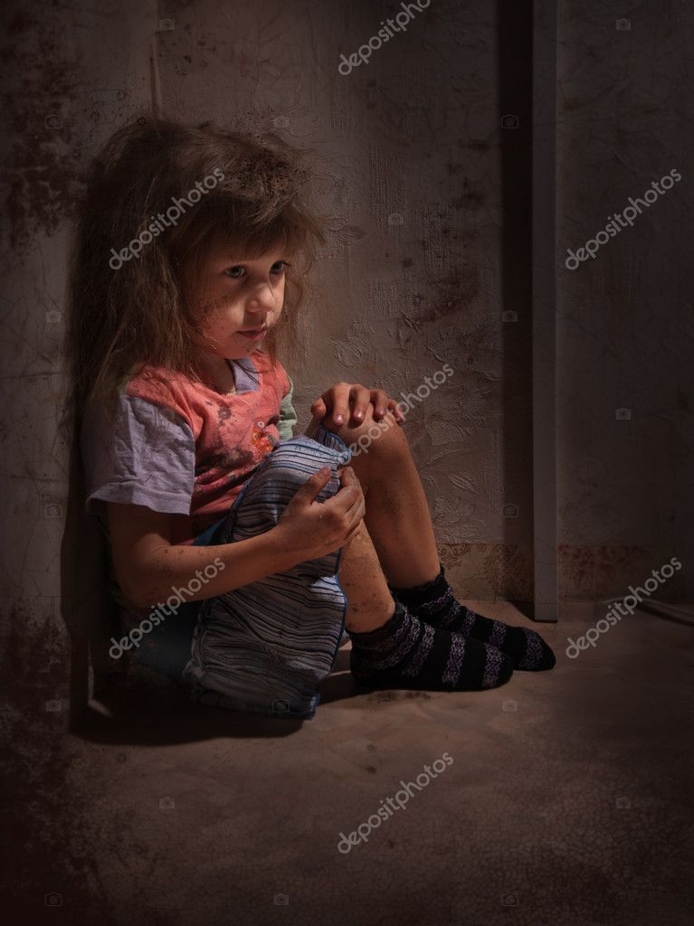 Child alone in a dark corner  Stock Photo #9723982