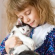 Royalty-Free Stock Photo: Girl hugging a kitten