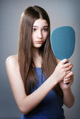 Teen girl with a mirror — Stock Photo