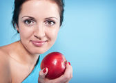 Girl and apple — Stock Photo
