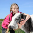 Little girl with calf — Stock Photo #10634449