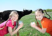 Little girls drinking milk — Stock Photo