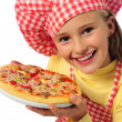 Little girl with pizza - Stock Photo
