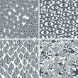 Four black and white seamless patterns. — Stock Vector