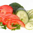 Green salad, sliced tomato and cucumber isolated on the white ba — Stock Photo