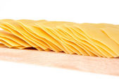Lasagna pasta on cutting board isolated on white background — Stock Photo