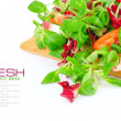 Fresh mixed salad with tomatoes on a white background — Stock Photo #7996731