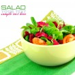 Fresh salad is in a dish on a white background — Stock Photo